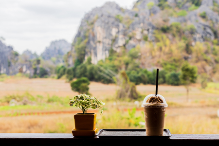 Cold coffee amid nature and mountains