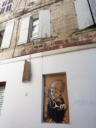 window graffiti: Mural painting on a street in Avignon, France