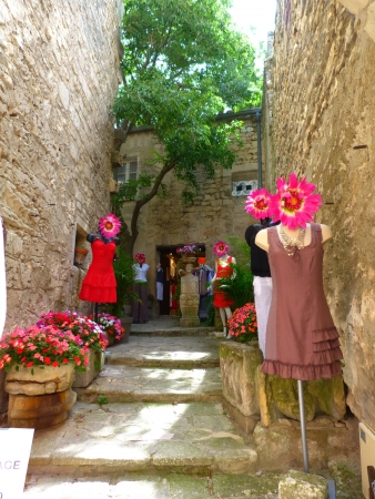 Street with mannequins in the village of Baux, Provence, France photo