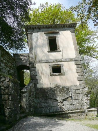 Ancient leaning building in the park of the Monsters in Bomarzo, Italy photo