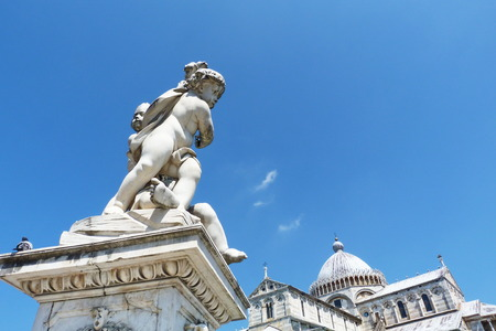 PIsa Cathedral in Square of Miracles with the fountain of cherubs in the foreground, Tuscany, Italy photo