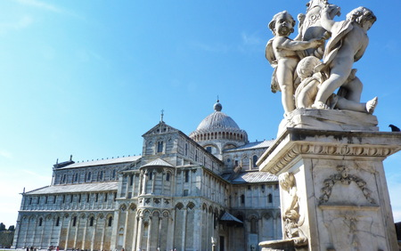 cherubs: PIsa Cathedral in Square of Miracles with the fountain of cherubs in the foreground, Tuscany, Italy