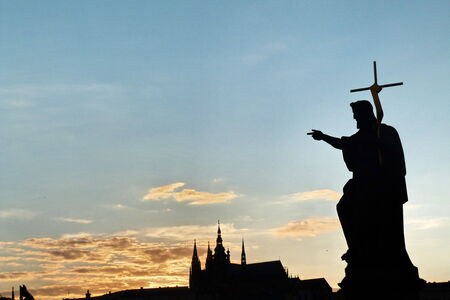 St.Vitus Cathedral and statue on Charles Bridge at sunset, Prague, Czech Republic photo