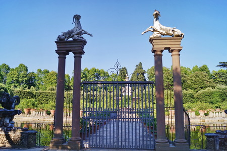 grotesque: Gate with capricorns and harpys in Island Fountain Boboli Gardens Florence Tuscany Italy.