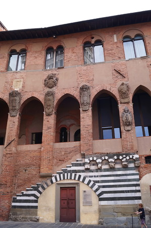 article of clothing: Facade of the Old Bishops Palace, Pistoia, Italy Editorial