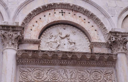 bass relief: Detail of Santa Maria Foris Portam church, Lucca, Tuscany, Italy