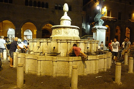 cavour: Medieval fountain on Piazza Cavour at night, Rimini, Italy. Editorial