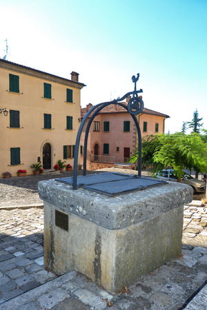 emilia: Well in a square of San Leo, Emilia Romagna, Italy Stock Photo