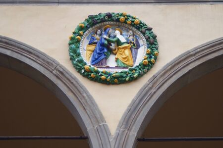 Detail of portal frieze of the Ospedale del Ceppo, Pistoia, Italy