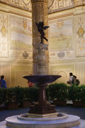 Fountain of putto with dolphin by Verrocchio at night, Palazzo Vecchio, Florence, Italy