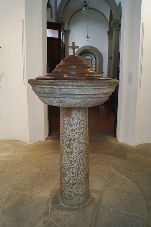 Baptismal font in the Holy Cross church, Vinci, Tuscany, Italy