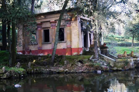 Pond and Egyptian temple in the park of Villa Stibbert in Florence, Italy