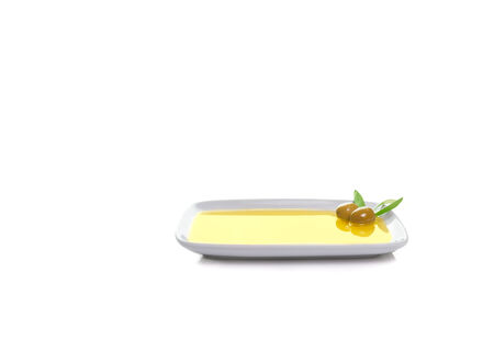 spreads: olive oil on plate isolated on white background