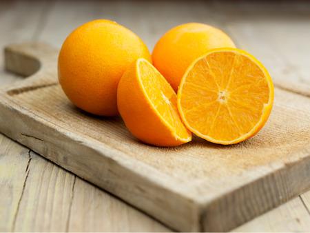 Oranges isolated cut set on wooden base Archivio Fotografico