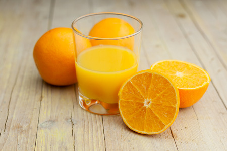 Composition of orange cut glass with juice