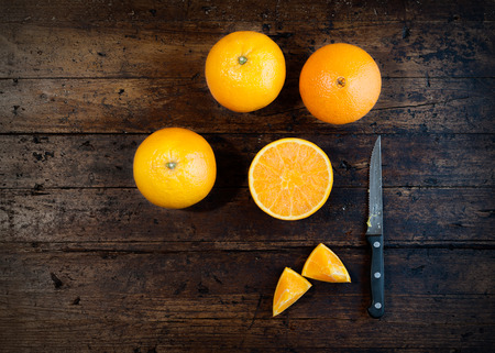 orange color: Oranges isolated cut set on wooden base Stock Photo