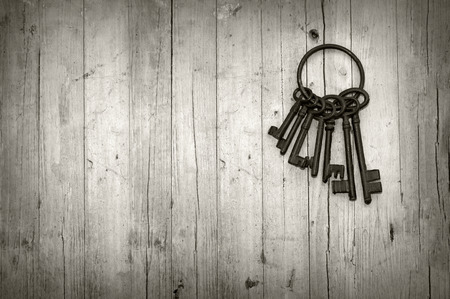 bunch of old keys on wooden background black and white Banco de Imagens - 30642697