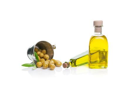 olive oil bottle: bottle of olive oil with olives isolated dump bucket on white  Stock Photo
