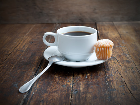 coffee and cake: muffins with coffee cup on wooden table