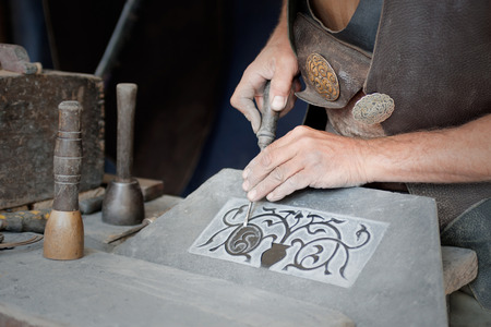 trabajo: craftsman working on stone isolated on hands Stock Photo