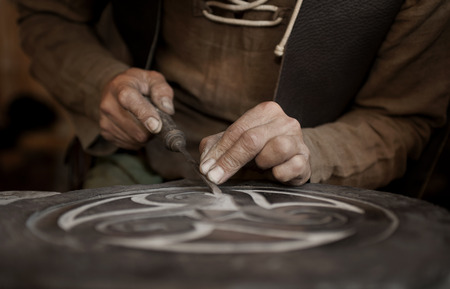 craftsman working on stone isolated on hands Archivio Fotografico