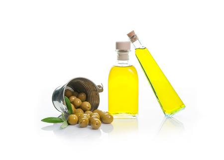 bottle of olive oil with olives isolated dump bucket on white background photo