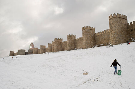 walled city with snow on all around photo