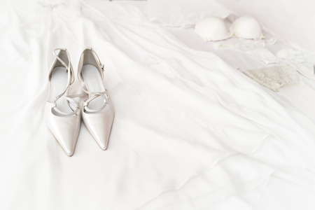 bridal shoes on the bed with white background photo