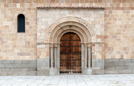 barrel tile: church door with arch and aged wood Stock Photo