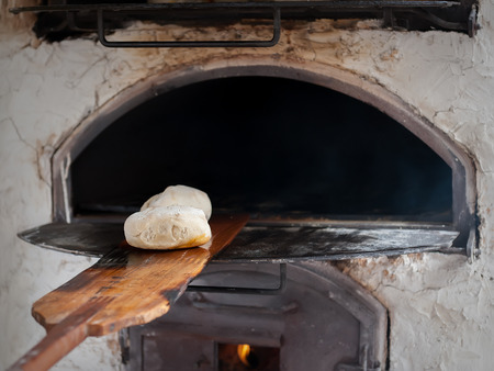 baker's: Introducing mass baker of bread in wood stove