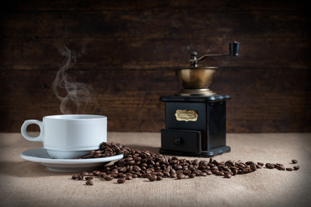 decaffeinated: coffee beans on fabric tablecloth With aged wood background Stock Photo