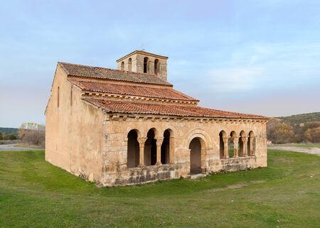 main facade Romanesque church surrounded by cesced
