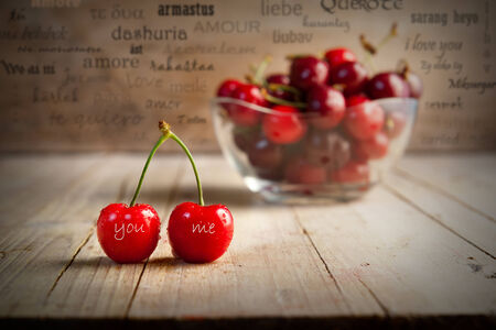 loves: set of cherries with blurred background lyrics in different languages