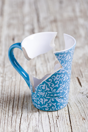 part of me: porcelain cup broken into pieces and stuck again Foto de archivo