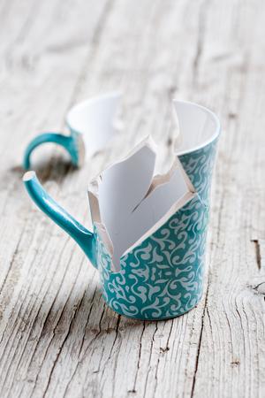porcelain cup broken into pieces and stuck again Foto de archivo