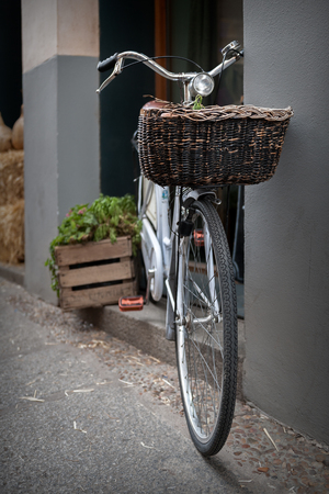 original bike: bike in the foreground with wicker basket and wooden boxes background