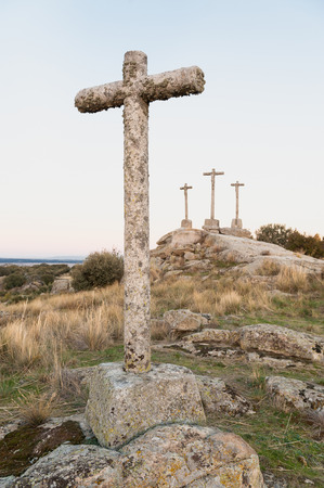 resuscitate: Three Crosses of carved stone on granite rock at dusk of Heaven