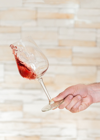 wine taster with the glass of the hand