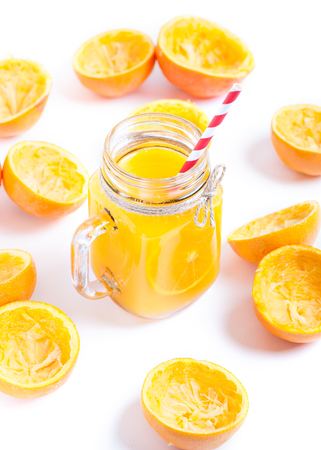 dieta: Orange juice with remains of shells in glass jar