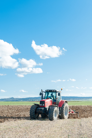 agricultural machinery working the land in the field Stock Photo
