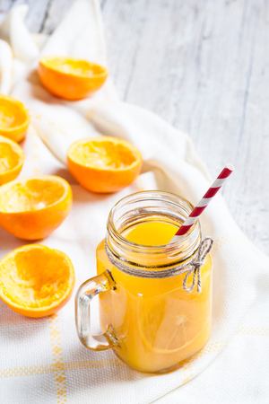 Orange juice with remains of shells in glass jar