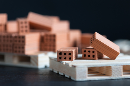 Clay bricks used for close-up miniature on black background 스톡 콘텐츠