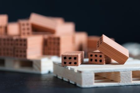 Clay bricks used for close-up miniature on black background Standard-Bild