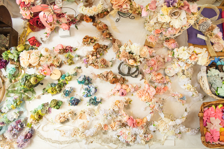 Various colorful artificial flowers, handmade by artisan and exposed in medieval market