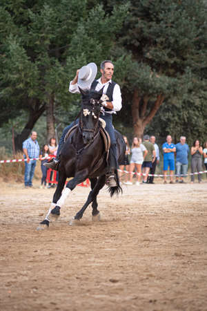 rider on his horse, performing dancing and dressage with him, in exhibition held in the town of Serranillos, Avila, Spain, on August 31, 2019 Editorial