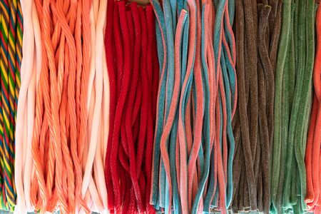 liquorice candy in the foreground with funny colors