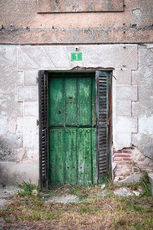 old village door in green, combined with complementary tones