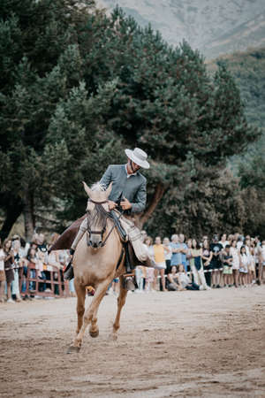 riding horseback riding in horse dressage and dance exhibition, held in the town of Serranillos- Avila- Spain, during the month of August 2019 on the occasion of the horse fair