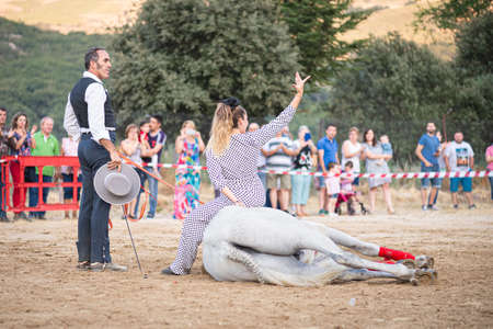 rider on his horse, performing dancing and dressage with him, in exhibition held in the town of Serranillos, Avila, Spain, on August 31, 2019 Editoriali