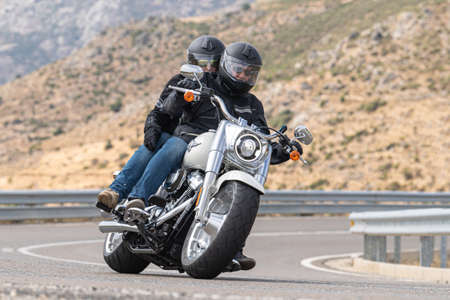 biker circulating on asphalt; photograph captured during the month of September 2020 in the province of Avila, Spain. Publikacyjne